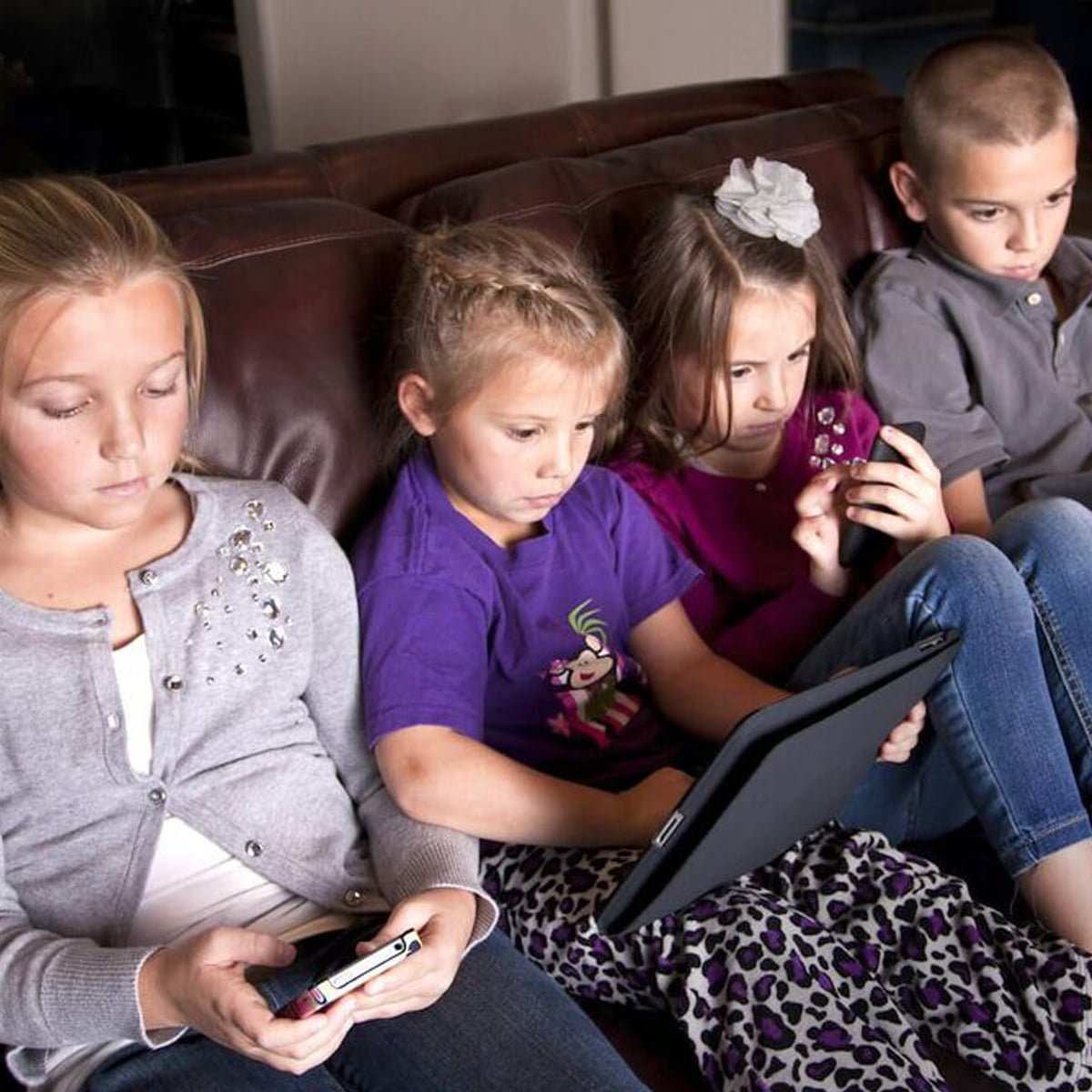 Four kids spending too much screen time on their devices
