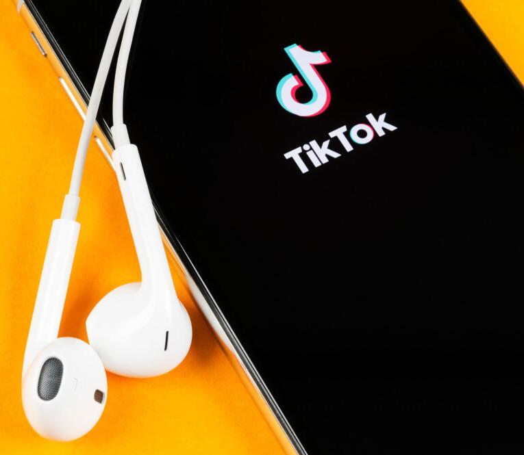 TikTok mobile app with Apple earphones